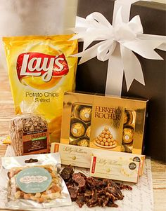 Buy or Send a gift box containing a variety of snacks like chips, chocolates, biltong, nuts and nougat in South Africa. | Item Code RA1826