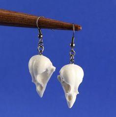 Plastic sparrow skull earrings