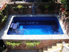 Above ground pools have always been the best and the cheapest option to build swimming pool. Here's the reason why you should invest in above ground pool rather than in-ground ones. We have above ground pool tips and ideas. Above Ground Pool Landscaping, Small Backyard Pools, Backyard Pool Landscaping, Above Ground Swimming Pools, Small Pools, Swimming Pools Backyard, Swimming Pool Designs, Pool Decks, In Ground Pools