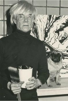 Andy Warhol and his dog at the studio, 1985. Photo by Beth Phillips.