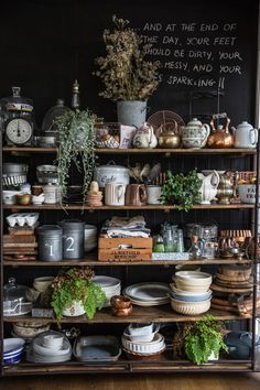 """Vintage luggage trolley laden with props makes Roy feel happiest about her home. When objects are switched out, it instantly changes the look and feel of the blackboard wall against which it is set."""
