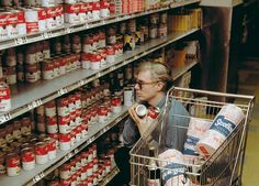 Andy Warhol in Gristede's supermarket near 47th street Factory, NYC1965. Photo byBob Adelman.