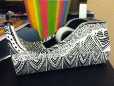 Tape dispenser that I drew on with a white sharpie paint pen