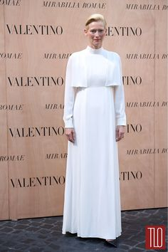 """Tilda Swinton at the Valentino 'Mirabilia Romae' haute couture show at Piazza Mignanelli in Rome, Italy. """"Pope Tilda the First is here, darlings. Kiss her ring."""" -Tom & Lorenzo"""