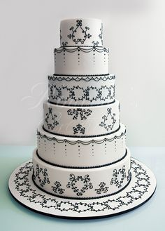 Design is based on Cake Boss's Black and White 6 tier wedding cake. 3 large sugar roses replaced the anemone flowers. Roses were added at the venue