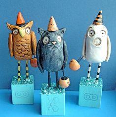 owl, cat, ghost sculptures