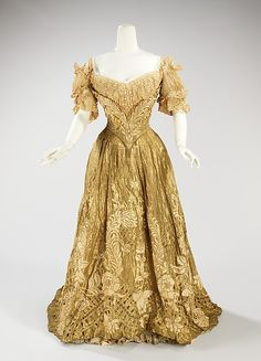 Embroidered gold silk lamé ball gown, by Jacques Doucet, French, 1898-1902. This piece is an exquisite example of a lavish ball gown made by one of the grandest French couture houses of the period. The material used is of the finest quality, extremely delicate and dramatically embroidered. The cut of the bodice is quite seductive, enhancing the silhouette.