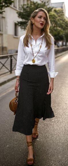 Looking put-together when the weather makes you want to fall apart isnt easy. Here's your heat-proof uniform // White button-down shirt, black and white polka dot midi-skirt, wrap-around ankle str Workwear Fashion, Office Fashion, Work Fashion, Fashion Outfits, Street Fashion, Workwear Skirts, Fashion Shoes, Fashion Beauty, Black Women Fashion