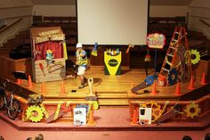 "OK, this is a WOW VBS scene from Tucker First UMC, Tucker, GA! Notice how the bikes are used in the assembly area. This idea is a great one to use to give the ""look and feel"" of motion for G-Force VBS! And it is something you have! www.cokesburyvbs.com"
