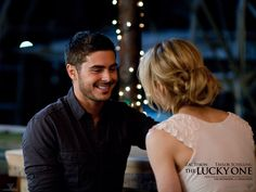 Logan (Zac Efron) and Beth (Taylor Schilling) in THE LUCKY ONE - can't wait until April 20th! http://www.facebook.com/TheLuckyOneMovie