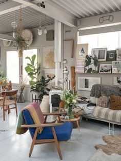 I've always had a thing for catching a peek into the interiors of outwardly interesting looking houses.  And did it ever lead me to a treat this time... This modern, magical warehouse revival in London is all that and then some.