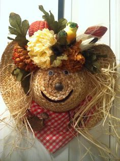 Scarecrow wreath made from a straw hat