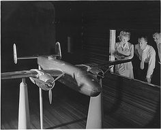 North American Aviation, Inc., observing wind tunnel tests on an accurate scale model of a B-25
