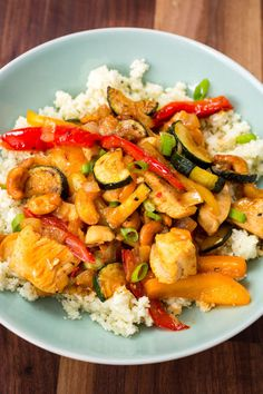 Skinny Cashew Chicken with Cauliflower Rice (cauliflower, garlic, lime, zucchini, bell pepper, green onion)