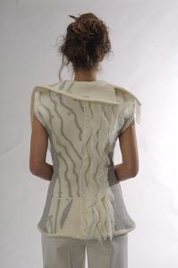 Vest   Description:  Felted merino wool and silk chiffon with shawl collar.   Dimensions:  H:1.00 x W:1.00 x D:1.00 Inches