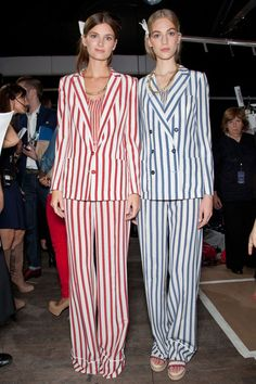 Models Ava Smith and Vanessa Axente show off their stripes backstage.  Image via Style Bistro, c/o ImaxTree.
