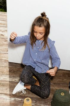 Stripe button up shirt with ruffle, pom Pom joggers, and white sneakers. Zara kids.