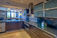 Enjoy cooking in this beautiful kitchen!  Sleek and modern yet functional.   Interested in learning more about this listing?  Send us an email at info@livelovescottsdale.com
