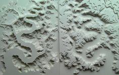 Cut paper sculptures by Rogan Brown.