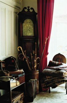 Gentleman's hats  canes, a towering grandfather clock and a bundle of plaid blankets embody heirloom-inspired, estate living