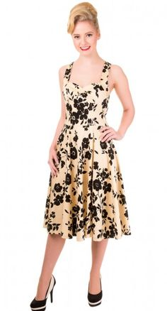 You don't often come across a classic pin up beauty like the After Midnight Floral Dress.