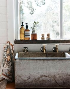 Décor Inspiration : Concrete Jungle -- a slideshow of 12 images of inspiration for decorating with concrete at home, from countertops to fireplace mantels.