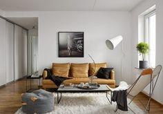 Een neutraal kleurenpalet siert dit Zweedse appartement