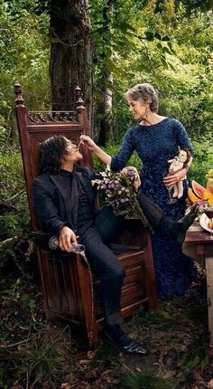 NORMAN REEDUS AND MELISSA McBRIDE.