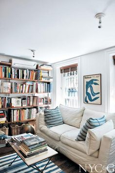 Rows of bookshelves in the comfortable living room of fashion designer Rebecca Taylor