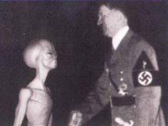 Heilige scheiße! This rare photo caught Adolf with his master Goballus. Hitler was like a puppet on a string fulfilling the evil alien's every wish.