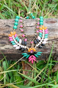 How easy would it be to pair this necklace with an outfit?! Green, pink, orange, cream, and black colors make this piece super versatile and easy to match