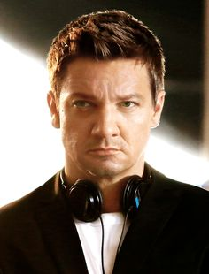 Jeremy Wearing White T-Shirt, Black Suit Jacket and Headset Around His Neck While Filming Remy Martin Commercial