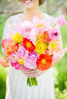 Brides: Bouquet of Poppies and Ranunculuses. Bouquet of poppies, ranunculuses, mimosa, peonies, sweet peas, and tulips, $300, Bows and Arrows