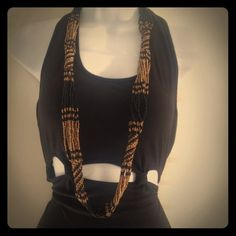 FINAL SALE! Gorgeous handmade statement necklace Handmade in Bali, beautiful gold, and black beads woven into native inspired statement necklace for a unique and bold layered look. A great piece! Happy shopping:) handmade Jewelry Necklaces
