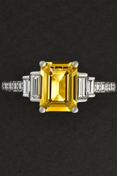 The perfect symbol of your love. For now and forever. Get inspired by this gorgeous Taylor & Hart ring - an emerald-cut yellow sapphire with diamond baguette side stones and bead-set white diamond band.
