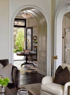 House Tour: Connecticut Shore Rounded archways, white wood, alternating black and white tiles - Model Home Interior Design Design Entrée, House Design, Design Ideas, Rustic Design, Food Design, Design Projects, Style At Home, Beautiful Interiors, Beautiful Homes