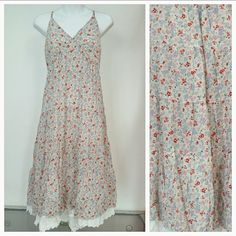 "Prairie Dress NWT Brand new with tag.   Floral Prairie dress with white trim around bottom spaghetti straps are adjustable. Prairie styles are all over the runway for summer/spring!  Approx 42"" long but length will vary depending on where you adjust your strapes 100% rayon Dresses"