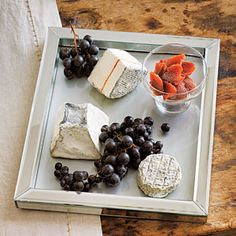 For a Gothic-looking cheese platter, arrange ashy cheeses (like goat) on a tray with dark grapes and quince paste.