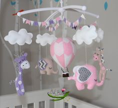 With MUSICAL CRIB ATTACHMENT. Pale pink, lavender, taupe & white hot air balloon, elephants, giraffes musical rotating mobile. Made to order by BabyBeansNZ on Etsy