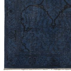 Spice Market Overdyed Rug from  Williams Sonoma in shades of blue with a subtle black design.