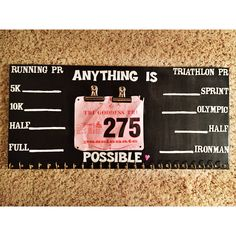 Running and triathlon bib and metal holder. PR tracker.