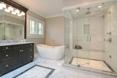 Hellyer Custom Builders: master bathroom with glass shower, soaking tub, dark cabinets, and white marble. Tub Shower Combo, Shower Tub, Rain Shower, Bathroom Kids, Master Bathroom, Bathrooms, Craftsman Bathroom, Small Floor Plans, White Sink