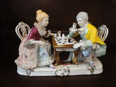 ornamental lady and gentleman figurine after the style of meissen