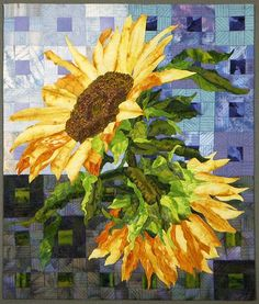 Two Sunflowers by Terry Kramzar (25 x 21) Machine pieced blocks with raw edge fused applique. Free motion machine quilted.