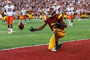 Robert Woods #2 of the USC Trojans flips the ball after scoring on a 31 yard touchdown catch in the second quarter against the Syracuse Orangemen at the Los Angeles Memorial Coliseum on September 17, 2011 in Los Angeles, California.