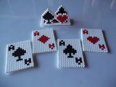 Perfect to save your table from damage, this set of coasters with their own stand will add a bit of originality to your home.  Made of fuse beads, each coaster is 8.5 x 6 cm and this set includes four.  Colours can be changed to suit your taste.  The stand where you keep the coasters has to b...