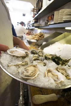 Kevin Sancimino from Swan Oyster Depot Shares Grilling Tips and the Best Types of Oysters to BBQ Freshly shucked oysters at Swan Oyster Depot. Post by Gina Scialabba. Photo: Sara Bloomberg.