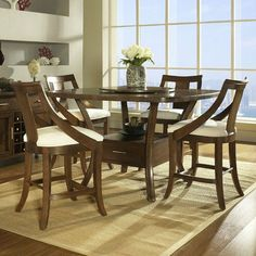 Gatsby 5 Piece Pub Table Dining Table Set in Medium Brown by Somerton. $1397.34. 422-68T Features: -Walnut veneers top matches sunburst pattern and ebony black inlay border.-Light burnishing.-Storage drawer on table base with satin nickel hardware.-No oil based cleaners.-Spot clean upholstery.-Dry or damp cloth only on furniture.-Barstool and server are optional. Includes: -Set includes counter height table and 4 barstools. Construction: -Hardwood solids and veneers construction....