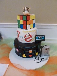 1980's themed wedding cake. Everything is 100% edible. including Gizmo, the Cassette Tape, and the Walkman. www.nadiacakes.com