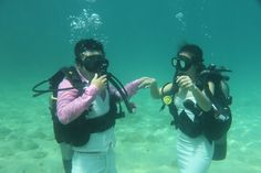 "Get married under the sea. A fun way to say ""I do"". Image courtesy of Blue Coral Diving"